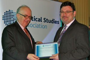 Prof Russell receives prize from Rt Hon Peter Riddell
