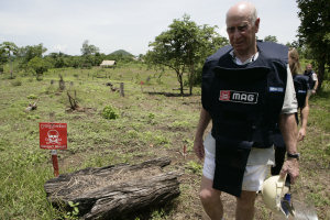 Sir Bobby Charlton on a visit to Cambodia to inspect landmine detection