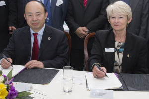 Professor Fang, PUHSC, and Professor Dame Nancy Rothwell sign the alliance