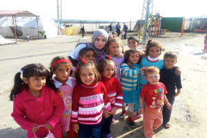 Researcher Aala El-Khani with children living on the refugee camp in Qah, Syria