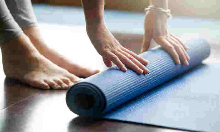Feet and hands on yoga mat