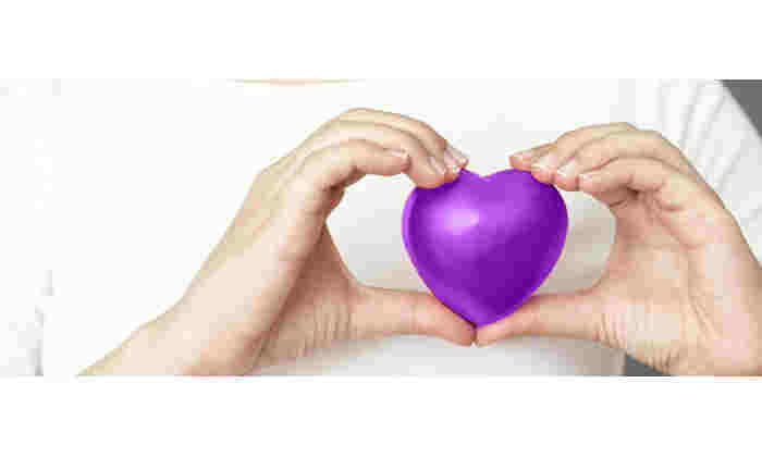 University staff Wellbeing heart in purple