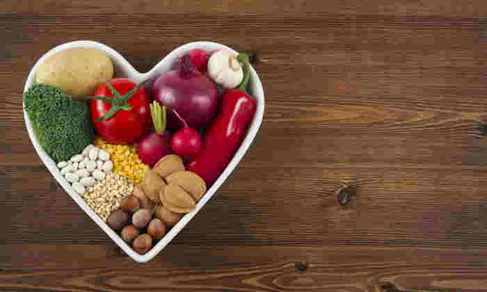 Healthy food in heart shaped bowl