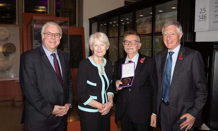 Emeritus Professor Tony Redmond receives medal from Nancy Rothwell