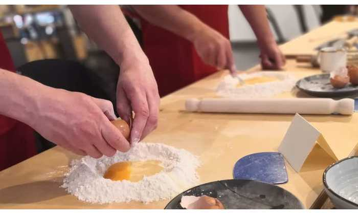 Picture of people making pasta