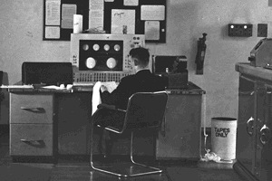 Alan Turing with the Manchester Mark 1 Computer