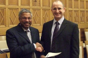 Dr Krishna Persaud getting his award from Prof Colin Hughes